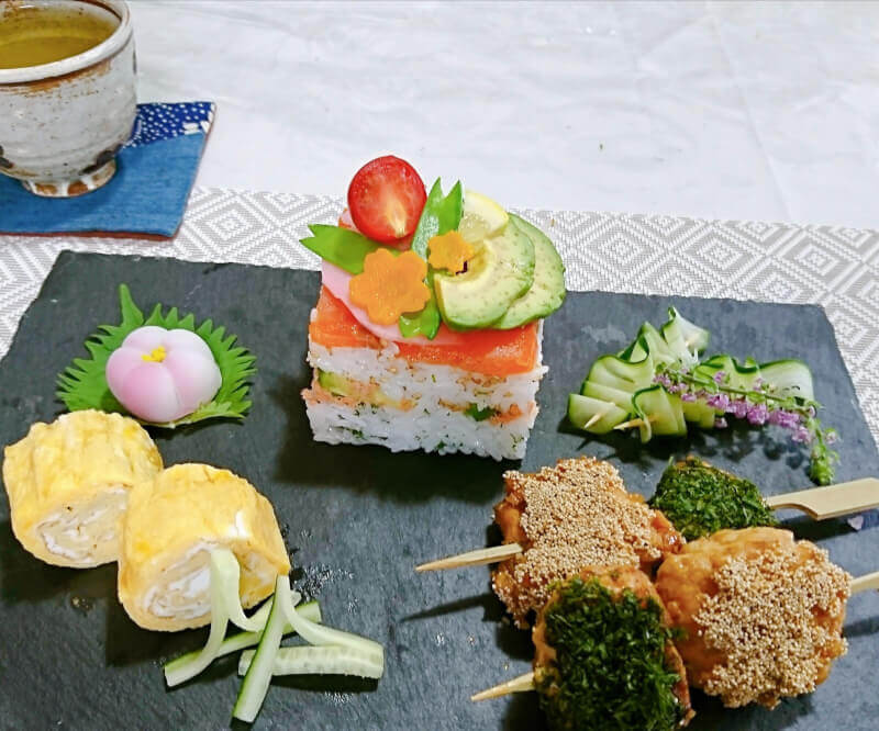 Colorful Oshi Sushi cooking near character's forest