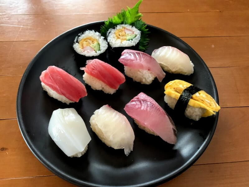 Sushi lesson, nigiri-sushi and rolled sushi with Japanese dashi-soup