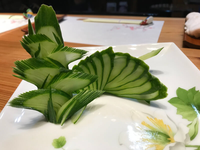 Decoration cut out with cucumber, tree and fan